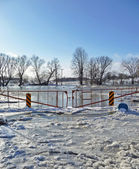 Rural winter bridge flooded and frozen — Stock Photo