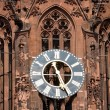 The clock of the Frankfurt cathedral - Stock Photo