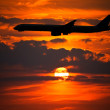 Plane Silhouette against Setting Sun — Stock Photo