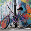 Street graffiti wall parked bycicle — Stok fotoğraf