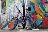 Street graffiti wall parked bycicle — Stock Photo