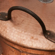 Copper lid pan handle handcrafted - Stock Photo