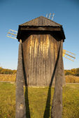 Wooden windmill back view — Stock Photo