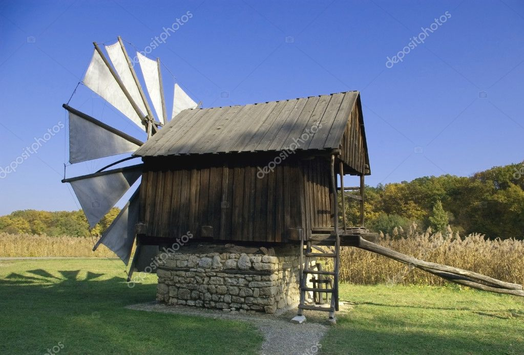 Old windmill wodden house and fabric blades  beautiful late evening light open-air museum Sibiu Romania — Stock Photo #2031079