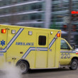Ambulance car speeding blurred - Stock Photo