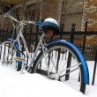Stock Photo: Bicycle in deep snow parked street