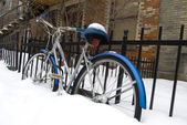 Bicycle in deep snow parked street — Stock Photo