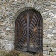 Stock Photo: Castle wood gate on stone wall