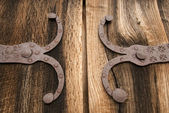 Detail of old oak wood gate with metal — Stock Photo