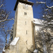 Church tower in winter village — Stock Photo
