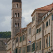 Houses and church tower in Dubrovnik — Stock Photo