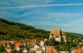 Fortified church over village — Stock Photo
