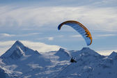 Paragliding in winter over mountain — Stock Photo