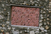 Brick wall and roof tile — Stock Photo