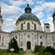 Baroque abbey tower and dome in bavaria - Stock Photo