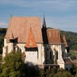 Fortified church with defence wall — Stock Photo #2465930