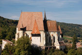 Fortified church with defence wall — Stock Photo