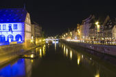 Bridge and quay in old town by night — Stock Photo