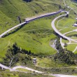 Stock Photo: Mountain road and tunnel in italialps