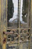 Door cross reflection in cemetery — Stock Photo