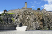 Fortress in switzerland town on rock — Stock Photo