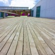 Stock Photo: Wooden decking and sculptures