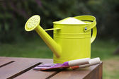Watering can still life — Stock Photo