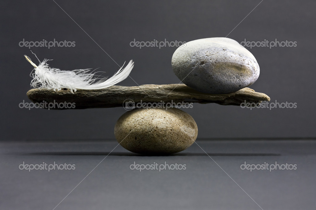 A feather and a stone equally balance — Stockfoto #1972300