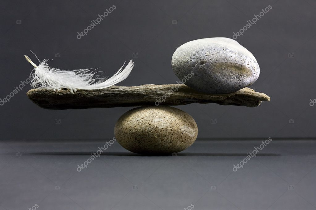 A feather and a stone equally balance — Foto de Stock   #1972300