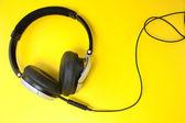 Headphones on yellow — Stock Photo