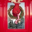 Stock Photo: Christmas front door with handmade reindeer wrea