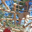 Father and son on climbing frame - Stock Photo