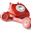Answering an old fashioned red telephone — Stock Photo