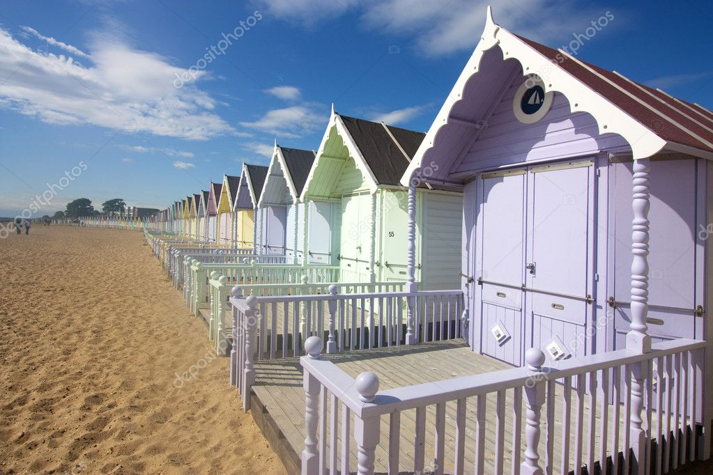 Mersea beach huts and cloudscape in summer — Stock Photo #2175759