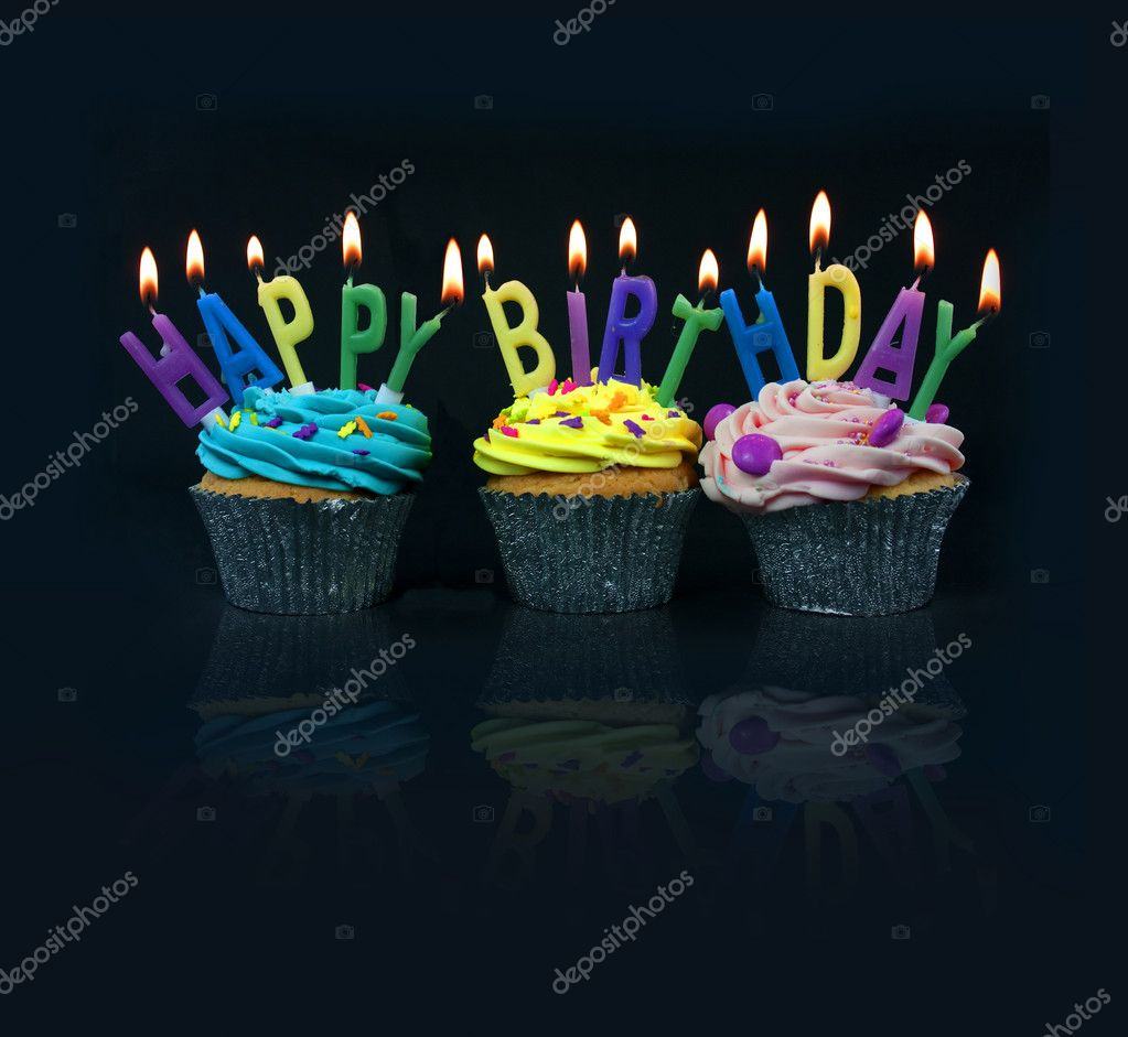 Cupcakes spelling out happy birthday on a black background with reflection — Stock Photo #2185734