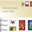 Christmas santa letter and stamps — Stock Photo