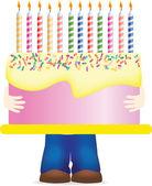 Carrying huge birthday cake — Stock Photo