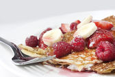 Raspberry and strawberry crepes or panca — Stock Photo