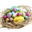 Stock Photo: Easter eggs in nest on white