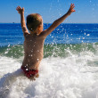 Young child playing in the waves — Stock Photo