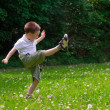 Child playing on grass — Stock Photo