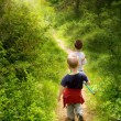 Young children walking in forest — Foto de stock #1992770