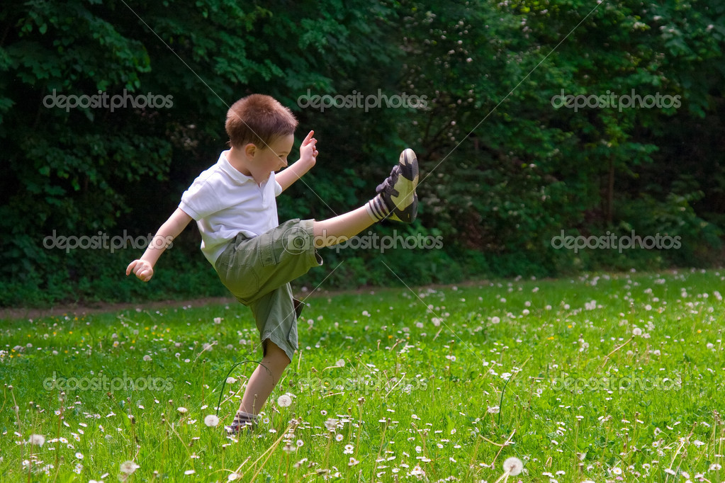 Young child playing on grass  Stock Photo #1992706