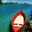 Red fishing boat on blue water — Stock Photo #2644943