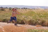 Young children running in the nature — Stock Photo