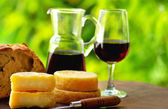 Red wine, bread and cheese. — Stock Photo