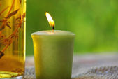 A candle and oil. — Stock Photo