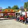 Carrousel and clorored cars. - Stock Photo