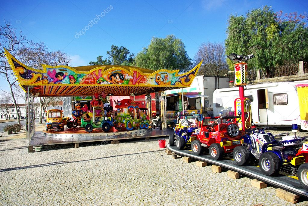 Carrousel and clorored cars. — Stock Photo #2087454