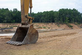 Backhoe at washed out lake — Stock Photo